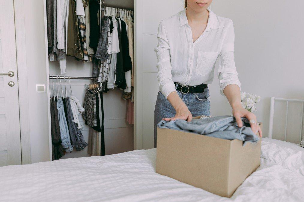 Girl sorting through her wardrobe